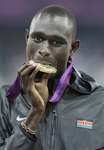 Kenya's David Lekuta Rudisha bites the gold medal