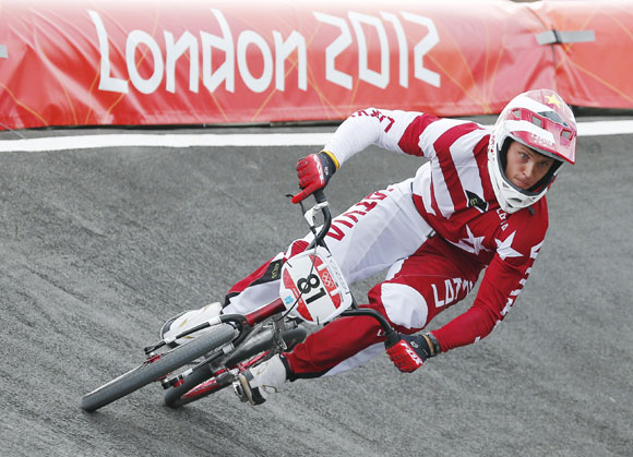 Latvia's Maris Strombergs competes in the men's BMX seeding run during the London 2012 Olympic Games at the BMX Track in the Olympic Park
