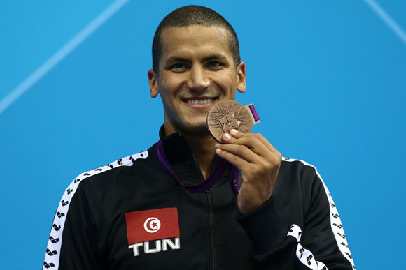 Bronze medallist Oussama Mellouli of Tunisia poses on the podium during the medal ceremony for the Men's 1500m Freestyle Final