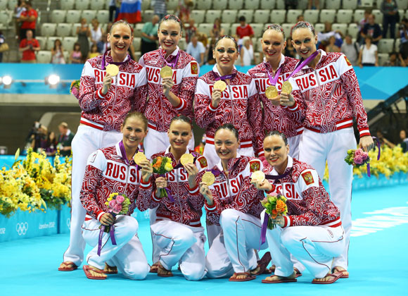 Gold medallists Russia pose on the podium during the medal ceremony for the Women's Teams Synchronised Swimming Free Routine final