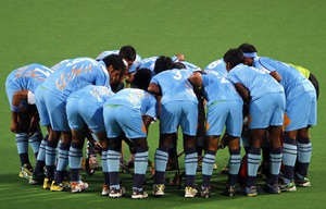 The Indian hockey team in a huddle before a match