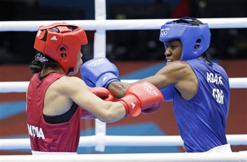 Great Britain's Nicola Adams, right, and India's MC Mary Kom