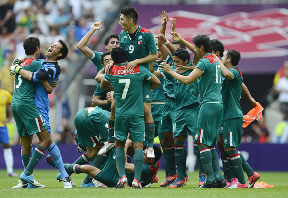 Mexico's players celebrate their victory over Brazil after their men's soccer final gold medal match at Wembley Stadium