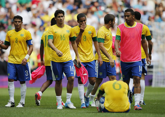 Brazil's players react after losing their men's football gold medal match against Mexico at Wembley Stadium