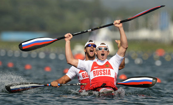 Russia's Yury Postrigay and Alexander Dyachenko celebrate after the men's kayak double (K2) 200m event