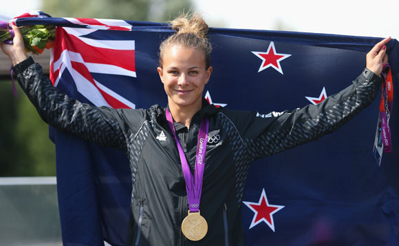 Lisa Carrington of New Zealand celebrates after winning the Gold medal in the Women's Kayak Single (K1) 200m Sprint Final