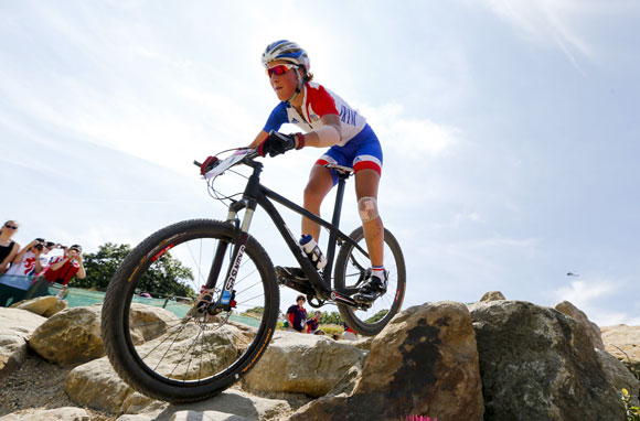 France's Julie Bresset competes to win gold during the women's Cross-country mountain bike cycling event