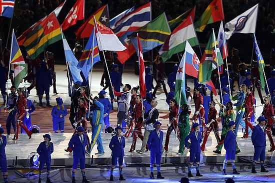 Flagbearers take part in the athletes' march