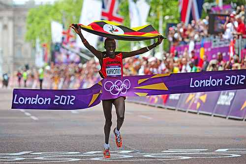 Stephen Kiprotich of Uganda celebrates as he approaches the line to win gold in the Men's Marathon