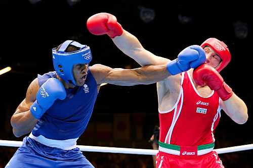 Anthony Joshua (L) of Great Britain exchanges punches with Roberto Cammarelle (R) of Italy during the Men's Super Heavy (+91kg) Boxing final bout
