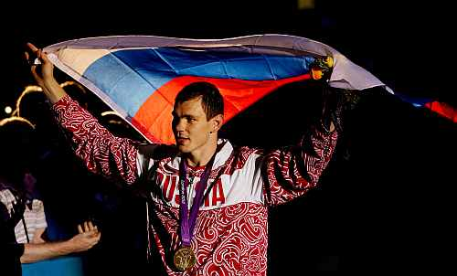 Gold medalist Egor Mekhontcev of Russia celebrates after the medal ceremony for the Men's Light Heavy (81kg) Boxing final bout