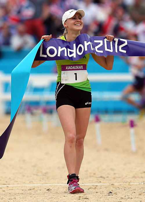 Laura Asadauskaite of Lithuania crosses the line in first place to win the Gold medal in the Women's Modern Pentathlon