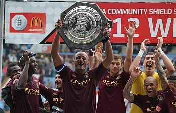 Vincent Kompany the Manchester City captain raises the trophy after their victory during the FA Community Shield matc
