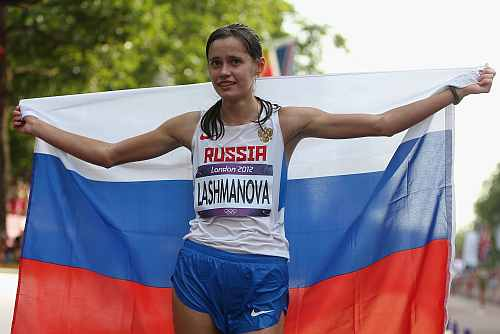 Elena Lashmanova of Russia celebrates after winning the Women's 20km Walk