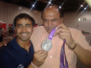 Sushil Kumar's brother Amarjeet (left) with coach Satpal