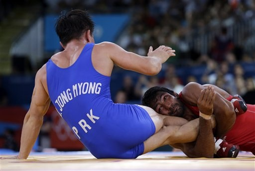 Yogeshwar Dutt has Ri Jong Myong of North Korea in a lock