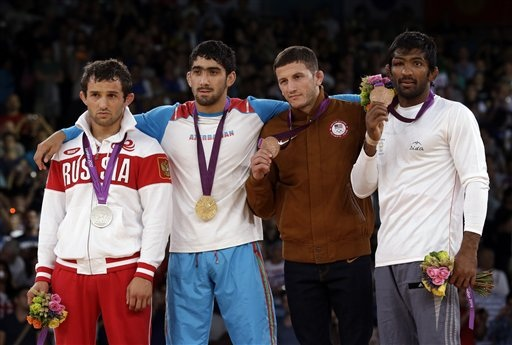 The medallists (left to right): Silver medalist Besik Kudukhov of Russia, gold medalist Toghrul Asgarov of Azerbaijan, bronze medalist Coleman Scott of the United States and Yogeshwar Dutt