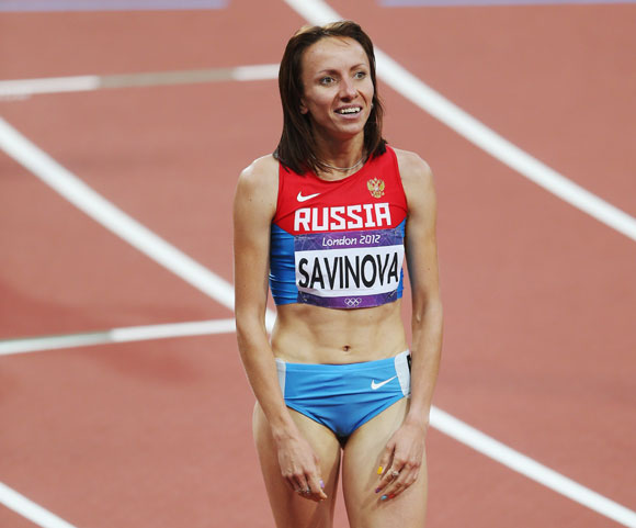 Mariya Savinova of Russia celebrates as she crosses the finish line to win gold in the Women's 800m Final
