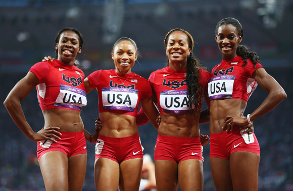 Francena McCorory, Allyson Felix, Sanya Richards-Ross and DeeDee Trotter of the United States celebrate winning gold in the Women's 4 x 400m Relay Final