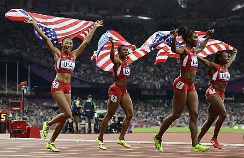 The U.S. celebrate after winning gold in the women's 4x100m relay final during the London 2012 Olympic Games at the Olympic Stadium