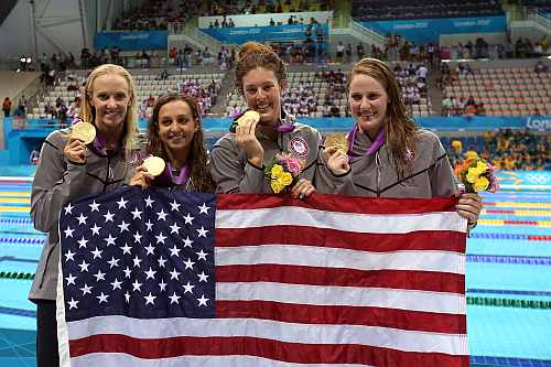 Gold medallists (L-R) Dana Volmer, Rebecca Soni, Allison Schmitt and Missy Franklin of the United States pose following the medal ceremony
