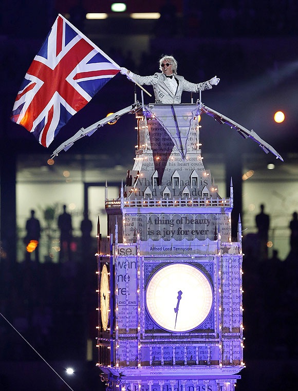A performer, dressed as Winston Churchill, stands atop the Big Ben as he participates in the closing ceremony of the London 2012 Olympic Games