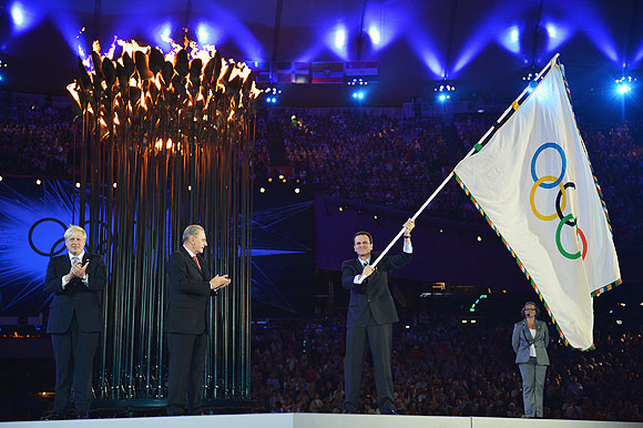 The Olympic Flag is handed from Mayor of London, Boris Johnson to IOC President Jacques Rogge, who passes it to Mayor of Rio de Janeiro, Eduardo Paes during the Closing Ceremony