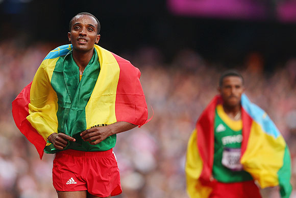 Dejen Gebremeskel of Ethiopia celebrates winning silver after the Men