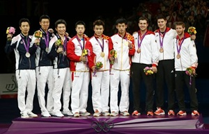 From left to right): Silver medalists Joo Seahjuk, Oh Sangeun and Ryu Seungmin of South Korea; gold medalists Ma Long, Wang Hao and Zhang Jike of China, and bronze medalists Timo Boll, Dimitrij Ovtcharov and Bastian Steger during the victory ceremony for the men's team table tennis
