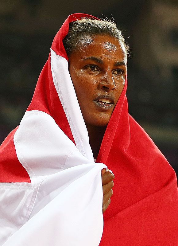 Bronze medalist Maryam Yusuf Jamal of Bahrain celebrates after the Women's 1500m final