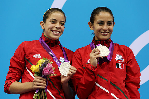 Silver medallists Alejandra Orozco Loza and Paola Espinosa of Mexico