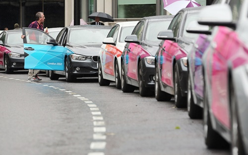 LOCOG vehicles wait to transport officials and dignitaries