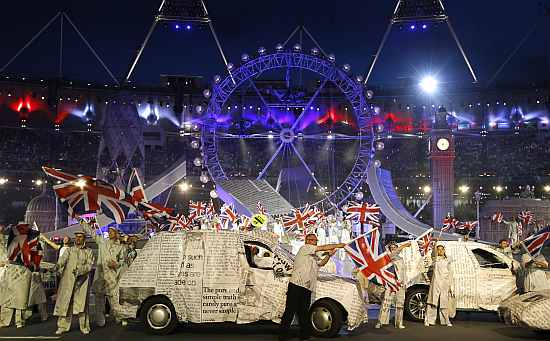 Performers wave British flags during the closing ceremony