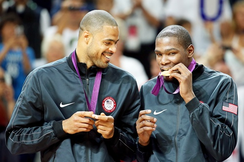 Gold medallists Tyson Chandler of the United States and Kevin Durant of the United States celebrate on the podium