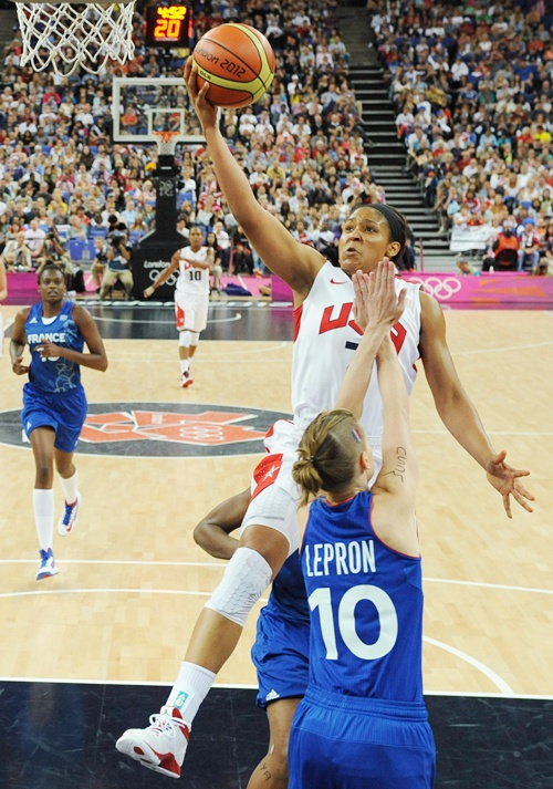 Florence Lepron of France tries to block Maya Moore of United States during the Women's Basketball Gold Medal game