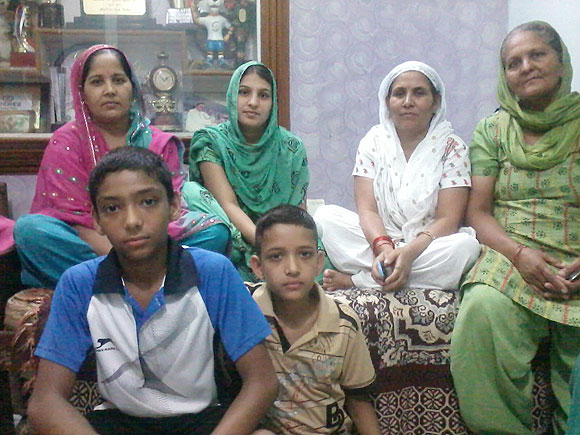 Sushil's mother Kamla Devi (2nd from right) and other relatives await his arrival at his home in Najafgarh