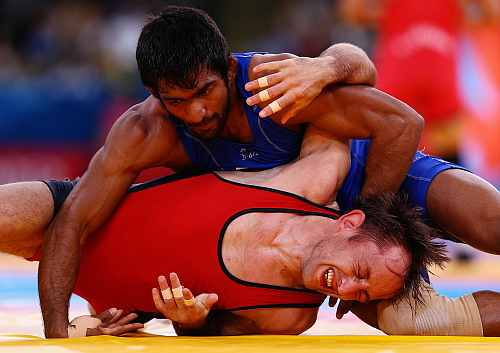 ogeshwar Dutt of India in action against Anatolie Ilarionovitch Gudea of Bulgaria in the Men's Freestyle Wrestling