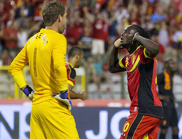 Romelu Lukaku of Belgium (right) celebrates as Netherlands goalkeeper Maarten Stekelenburg looks dejected during their soccer friendly at the King Baudouin stadium in Brussels