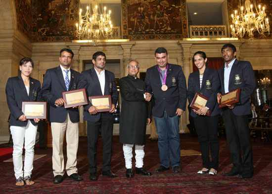 Pranab Mukherjee with the Olympic medal winners