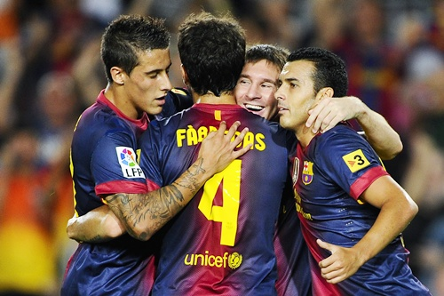 Lionel Messi of FC Barcelona (second right) celebrates with his teammates after scoring their second   goal