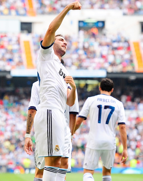Gonzalo Higuain of Real Madrid celebrates with teammates