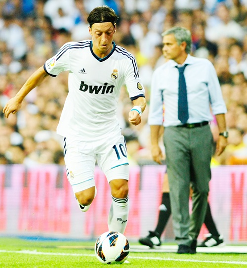Mesut Ozil of Real Madrid runs with the ball