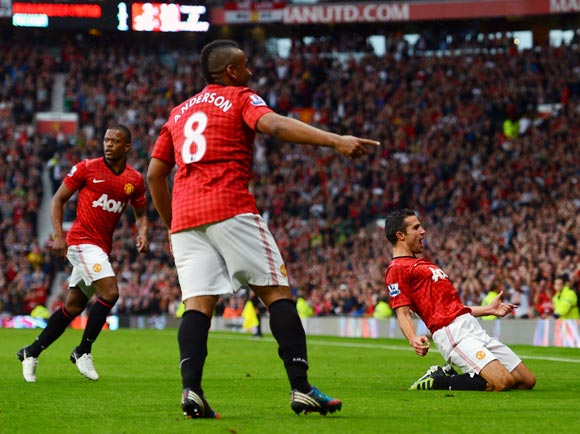 Robin van Persie celebrates after scoring the first goal