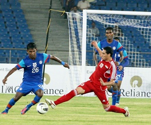 Francis Fernandes gets past Syria's Alaa Alshbbli in the first match of the Nehru Cup against Syria