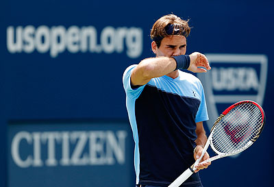 Roger Federer practices prior to the start of the 2012 US Open at the USTA Billie Jean King National Tennis Center