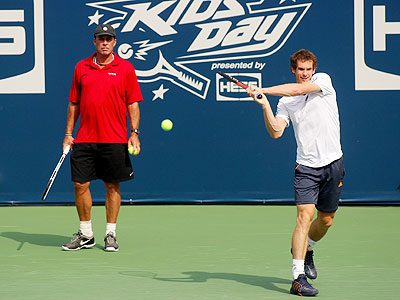 Andy Murray (right) practices as coach Ivan Lendl looks on