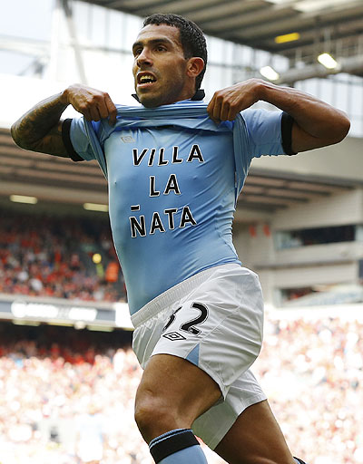 Manchester City's Carlos Tevez celebrates after scoring against Liverpoolon Sunday