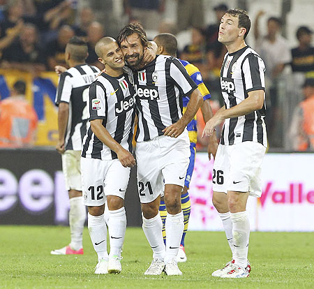 Andrea Pirlo (center) of Juventus FC celebrates with teammate Sebastian Giovinco (left) after scoring against Parma FC on Saturday
