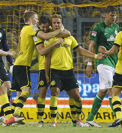 Borussia Dortmund's Marco Reus (eft), Mario Goetze (2nd from right) and Robert Lewandowski celebrate a goal against Werder Bremen on Friday