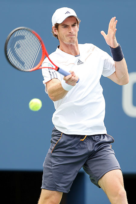 Andy Murray returns a shot against Alex Bogomolov Jr  during their men's singles first round match of the US Open on Monday